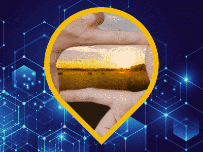 Hexagon background with image of two hands framing a sunrise over a landscape inside a GPS marker